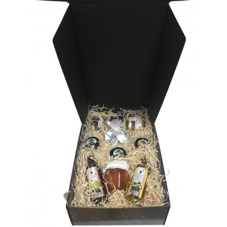 Petite caisse avec miel, huile, vinaigre, confitures, chocolats, fromage à la crème et pâtés pour cadeaux d'entreprise