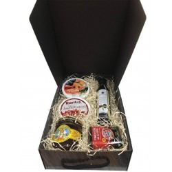 Small gift box with oil, cured ham, honey, paprika and tin oil, garlic and tomato for Christmas