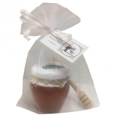 Détail avec un pot de miel orcio et avec un bâton de dégustation pour l'événement
