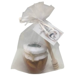 Honey jar with almonds and tasting stick for events