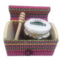 Colorful trunk with honey jar with nuts and tasting stick