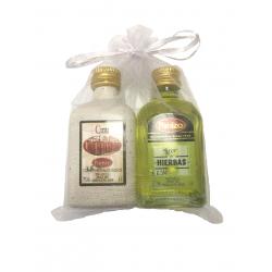 Pack de liqueur à base de plantes panizo et crème de marc de panizo dans un sac en organza