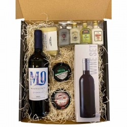Christmas basket with wine, spirits, cheeses, and spreads